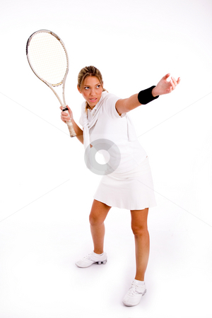 Front view of female playing tennis stock photo, Front view of female playing tennis against white background by Imagery Majestic
