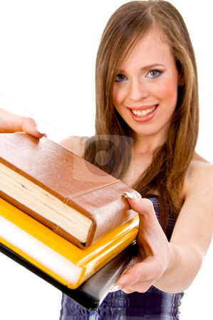 Front view of smiling student showing books stock photo, Front view of smiling student showing books against white background by Imagery Majestic
