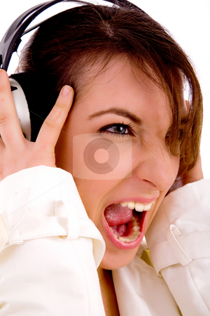 Side pose of screaming woman listening to music stock photo, Side pose of screaming woman listening to music with white background by Imagery Majestic
