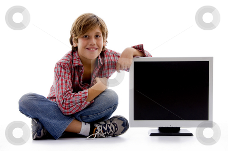 Front view of sitting boy with lcd screen  stock photo, Front view of sitting boy with lcd screen on an isolated white background by Imagery Majestic