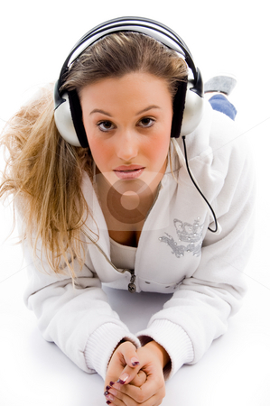 Woman with headphones stock photo, Young female busy with music against white background by Imagery Majestic