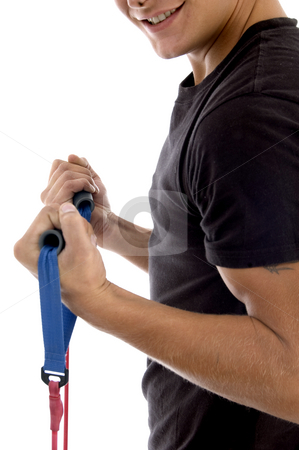 Man holding exercising rope stock photo, Man holding exercising rope with white background by Imagery Majestic