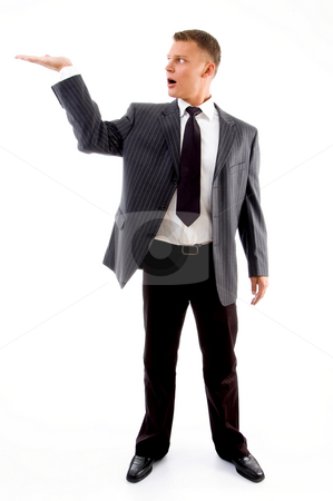 Standing adult handsome man with open palm stock photo, Standing adult handsome man with open palm against white background by Imagery Majestic