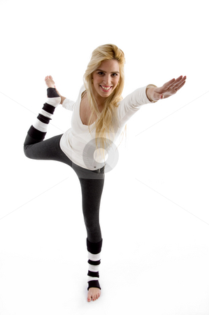 Front view of happy female exercising stock photo, Front view of happy female exercising with  white background by Imagery Majestic