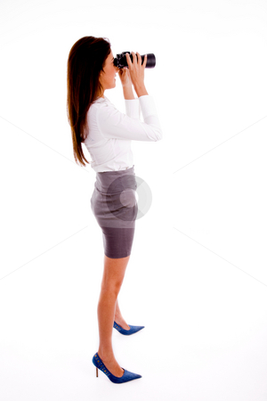 Side pose of executive looking through binocular stock photo, Side pose of executive looking through binocular with white background by Imagery Majestic