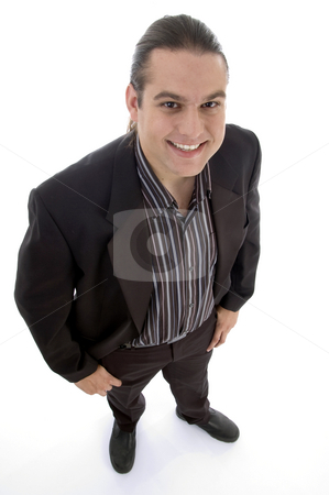 Smiling man looking upward stock photo, Smiling man looking upward against white background by Imagery Majestic