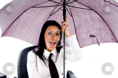 Woman holding umbrella stock photo, Woman holding umbrella against white background by Imagery Majestic