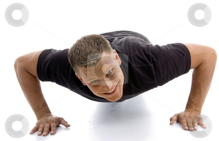 Male doing push ups stock photo, Male doing push ups with white background by Imagery Majestic
