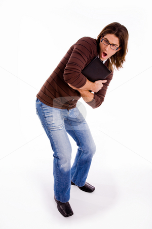 Side pose of shocked man carrying folder stock photo, Side pose of shocked man carrying folder on an isolated white background by Imagery Majestic