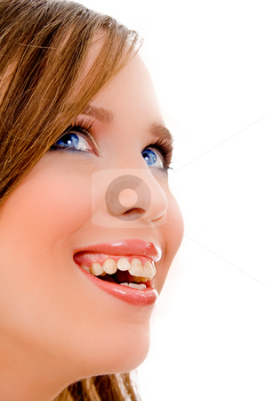 Smiling youg woman stock photo, Halflength view of smiling female face on an isolated white background by Imagery Majestic