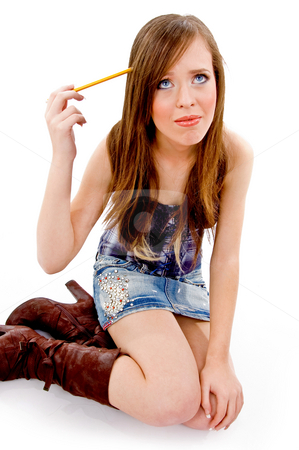 Top view of thinking student holding pencil stock photo, Top view of thinking student holding pencil on an isolated background by Imagery Majestic