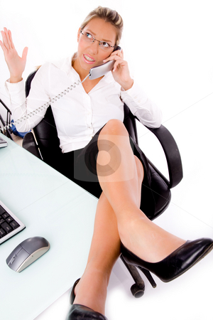 Top view of executive busy on phone stock photo, Top view of executive busy on phone  in an office by Imagery Majestic
