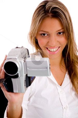 Smiling woman recording through camera recorder  stock photo, Portrait of smiling woman recording through camera recorder on an isolated background by Imagery Majestic