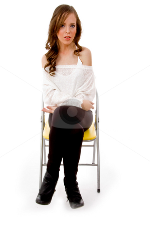 Front view of sitting female stock photo, Front view of sitting female against white background by Imagery Majestic
