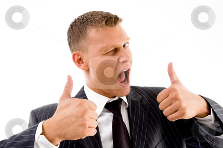 Successful professional person showing thumbs up stock photo, Successful professional person showing thumbs up on an isolated background by Imagery Majestic
