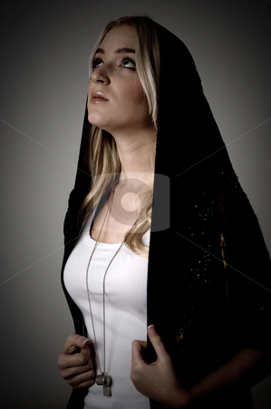 Side view of young female with stole looking up stock photo, Side view of young female with stole looking up on an isolated white background by Imagery Majestic