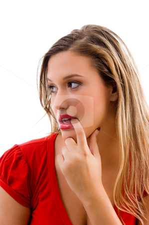 Woman biting her finger and looking sideways stock photo, Woman biting her finger and looking sideways on an isolated background by Imagery Majestic