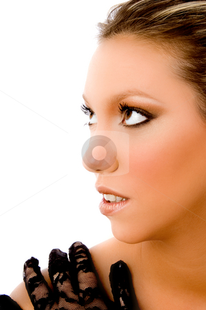 Half length view of young woman looking aside stock photo, Half length view of young woman looking aside on an isolated background by Imagery Majestic