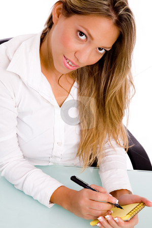 Top view of businesswoman writing on paper stock photo, Top view of businesswoman writing on paper  in an office by Imagery Majestic