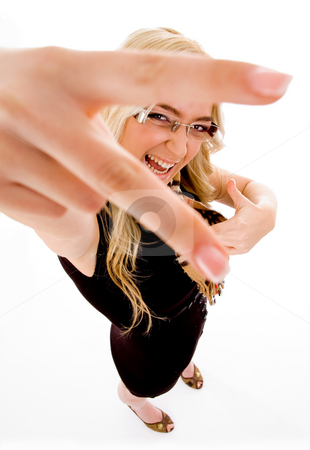 Top view of smiling model showing hand gesture stock photo, Top view of smiling model showing hand gesture with white background by Imagery Majestic
