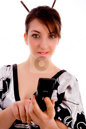 Front view of woman in kimono dialing number stock photo, Front view of woman in kimono dialing number on an isolated white background by Imagery Majestic