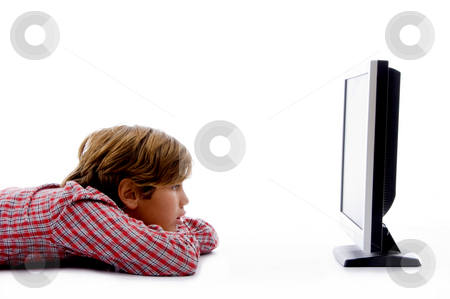 Side pose of boy watching tv  stock photo, Side pose of boy watching tv on an isolated white background by Imagery Majestic