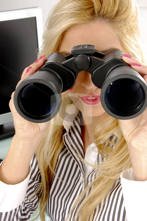 Front view of female looking through binocular stock photo, Front view of female looking through binocular in an office by Imagery Majestic