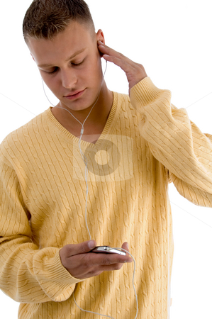 Man listening music through ipod stock photo, Man listening music through ipod on an isolated white background by Imagery Majestic