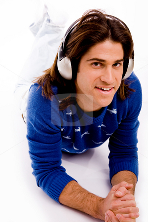 Top view of man listening music stock photo, Top view of man listening music on an isolated white background by Imagery Majestic