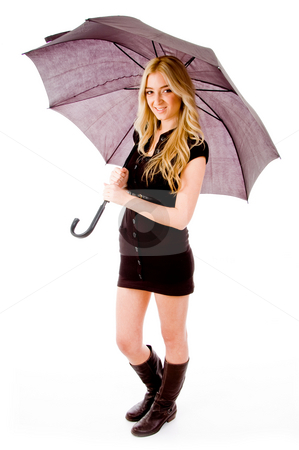 Side view of young woman carrying umbrella stock photo, Side view of young woman carrying umbrella on an isolated background by Imagery Majestic