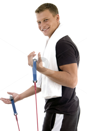 Side view of exercising man stock photo, Side view of exercising man on an isolated white background by Imagery Majestic