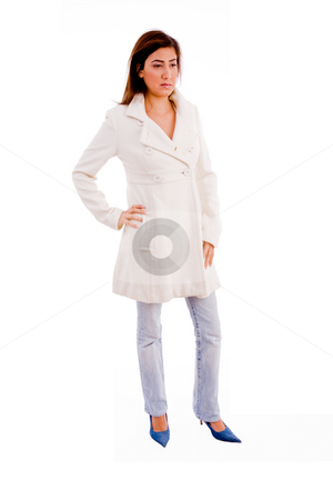 Standing model wearing overcoat stock photo, Side pose of standing model wearing overcoat with white background by Imagery Majestic