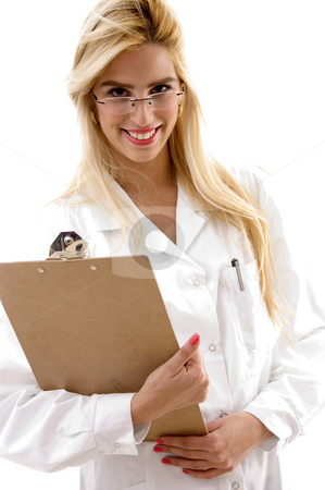 Portrait of smiling female doctor holding clipboard stock photo, Portrait of smiling female doctor holding clipboard on an isolated background by Imagery Majestic
