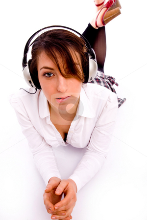 Front view of fashionable female enjoying music stock photo, Front view of fashionable female enjoying music on an isolated background by Imagery Majestic