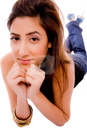 Front view of smiling young female looking at camera stock photo, Front view of smiling young female looking at camera on an isolated background by Imagery Majestic