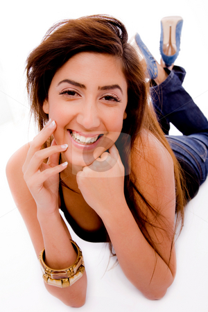 Front view of smiling young woman holding her face stock photo, Front view of smiling young woman holding her face with white background by Imagery Majestic