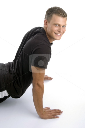 Muscular man doing push ups stock photo, Muscular man doing push ups on an isolated background by Imagery Majestic