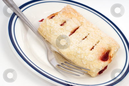 Desert stock photo, Closeup of a chery pastry desert on a plate with blue trim by Richard Nelson