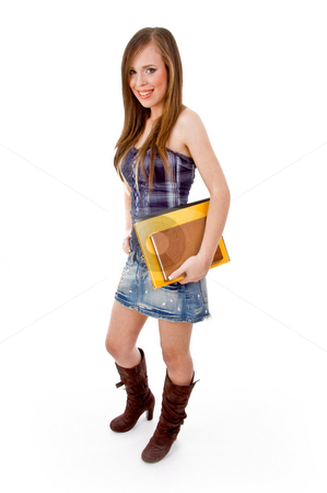 Full body of smiling young student with books stock photo, Full body of smiling young student with books on an isolated background by Imagery Majestic