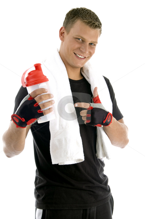Smiling man indicating bottle stock photo, Smiling man indicating bottle on an isolated background by Imagery Majestic