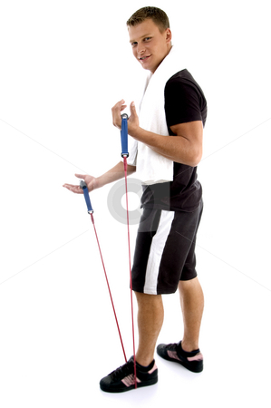 Exercising man holding rope stock photo, Exercising man holding rope against white background by Imagery Majestic