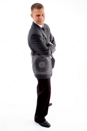Standing handsome male with crossed arms stock photo, Standing handsome male with crossed arms on an isolated white background by Imagery Majestic