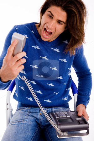 Front view of angry man shouting on phone stock photo, Front view of angry man shouting on phone on an isolated white background by Imagery Majestic
