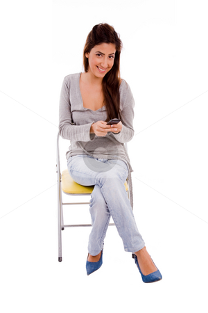 Front view of smiling woman holding mobile stock photo, Front view of smiling woman holding mobile on an isolated background by Imagery Majestic