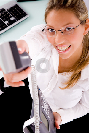 Top view of smiling businesswoman offering call stock photo, Top view of smiling businesswoman offering call  in an office by Imagery Majestic