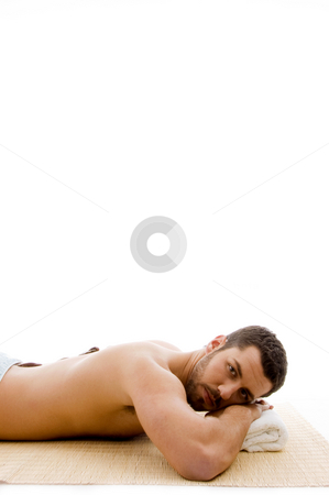 Side view of man lying down on mat at spa  stock photo, Side view of man lying down on mat at spa on an isolated background by Imagery Majestic