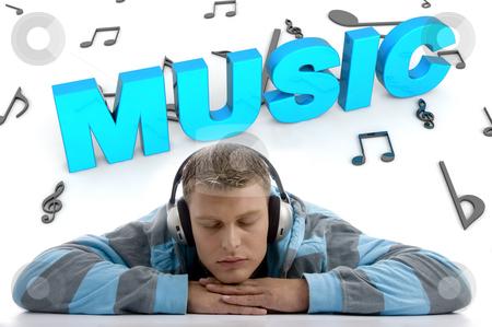 Laying man enjoying music stock photo, Laying man enjoying music on three dimensional musical background and music text by Imagery Majestic
