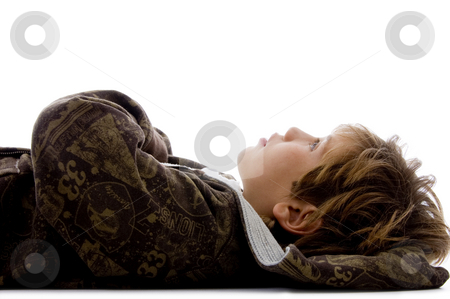 Side view of little kid resting on floor stock photo, Side view of little kid resting on floor against white background by Imagery Majestic