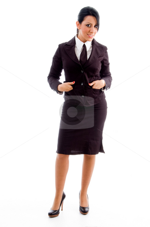 Young businesswoman standing stock photo, Young businesswoman standing on an isolated white background by Imagery Majestic