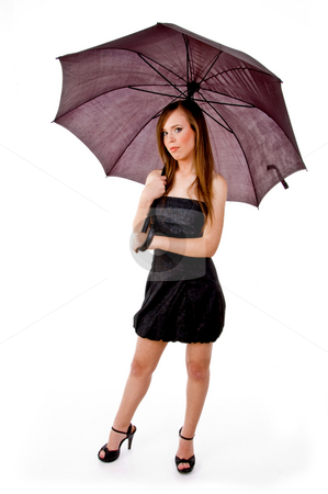 Front view of woman holding umbrella stock photo, Front view of woman holding umbrella on an isolated background by Imagery Majestic